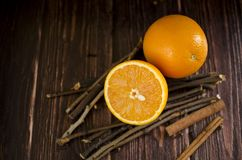 Orange slices are on a wooden table. Some orange slices are on a wooden table Royalty Free Stock Images