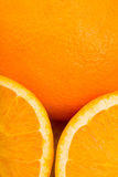 Some oranges. Oranges, some of them are halved slices royalty free stock photography