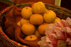 Oranges Decorated In A Basket with a Flower stock photography
