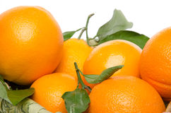 Some oranges with their leafs in a basket Stock Photos