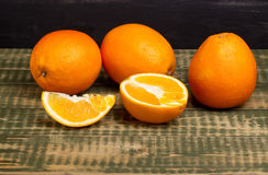 Some oranges on an wooden table. Some oranges on an old wooden table Royalty Free Stock Image