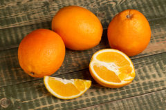 Some oranges on an wooden table. Some oranges on an old wooden table Royalty Free Stock Images