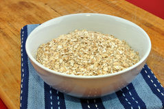 Some organic oatmeal. In a white bowl Stock Image