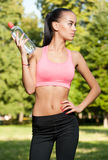 Some outdoors exercise. Gorgeous fit young brunette woman having some outdoors exercise Royalty Free Stock Image
