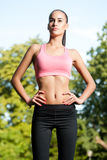 Some outdoors exercise. Gorgeous fit young brunette woman having some outdoors exercise Royalty Free Stock Photos