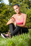 Some outdoors exercise. Gorgeous fit young brunette woman having some outdoors exercise Royalty Free Stock Photo