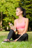 Some outdoors exercise. Gorgeous fit young brunette woman having some outdoors exercise Royalty Free Stock Photography