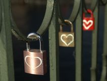Triple Hearts. Some of the padlocks left by visitors to the Vyšehrad Railway Bridge in Prague, Czech Republic royalty free stock photography