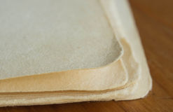 Some pages of an old writing-book. On a wooden surface close up Stock Photo