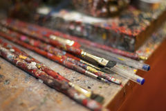 Some paint brushes in a candle shop of Siena, Italy. Soft focus Royalty Free Stock Photo