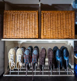 Some pairs of men's shoes. On SHOE RACK in the storeroom at home Stock Images