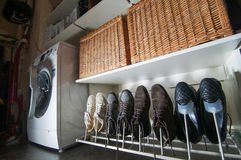 Some pairs of men's shoes. On SHOE RACK in the storeroom at home Royalty Free Stock Photo