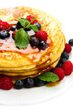 Some Pancakes with berries and maple syrup. Pancakes with berries and maple syrup Royalty Free Stock Photo