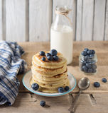 Some pancakes with blueberry and milk on the wood table. Rustic Royalty Free Stock Photography