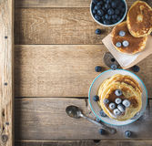 Some pancakes with blueberry on the wood table. Morning rustic mood Royalty Free Stock Photo