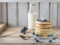 Some pancakes with blueberry on the wood table. Rustic, copy space Royalty Free Stock Photos