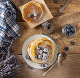 Some pancakes with blueberry on the wood table. Rustic, top view Stock Image
