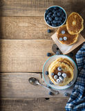 Some pancakes with blueberry on the wood table. Morning rustic mood Stock Images