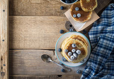 Some pancakes with blueberry on the wood table. Rustic, copy space Stock Images