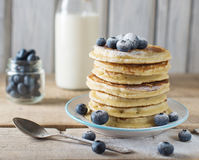 Some pancakes with blueberry on the wood table. Rustic, top view Royalty Free Stock Image