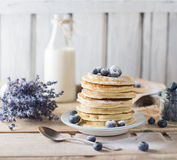 Some pancakes with blueberry on the wood table. Stack of pancakes with blueberry on the wood table, morning table Royalty Free Stock Photo