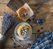 Some pancakes with blueberry on the wood table. Top view Stock Photo