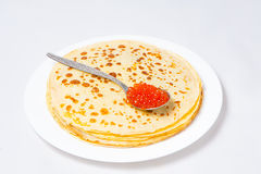 Some pancakes on the white plate. Some roasted pancakes on the white plate on white background Stock Photo