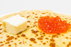 Some pancakes on the white plate with red caviar. Some roasted pancakes on the white plate on white background Stock Photography