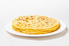 Some pancakes on the white plate with red caviar Stock Image