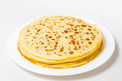 Some pancakes on the white plate with red caviar Royalty Free Stock Photo