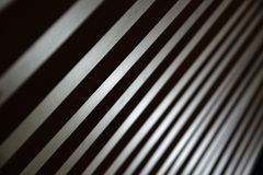 Some parallel lines creating a diagonal background. Low key backdrop with some strypes royalty free stock image