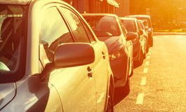 Some parked cars with the sun shining on them. Transportation concept Royalty Free Stock Image