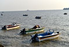 Speedboats are parked around the seashore area photograph. Some of the parked speedboats captured from a famous tourist spot in Bangladesh Royalty Free Stock Images