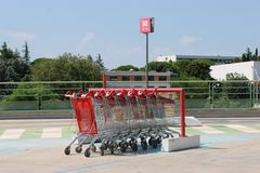 Some parked supermarket shopping carts stock photo
