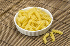 Some pasta in a bowl. Fusili in a White bowl Royalty Free Stock Image