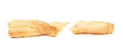 Some pastry sticks with sesame seeds. Puff pastry sticks with sesame seeds on white background Royalty Free Stock Image