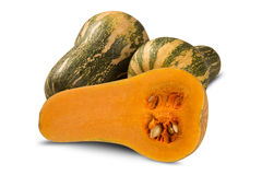 Some Paulistan pumpkins over a white background. Royalty Free Stock Photo