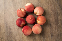 Some peaches in a basket over a wooden surface. Fresh fruits Stock Photography