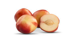 Some peaches in a white background. Fresh fruits Royalty Free Stock Photography