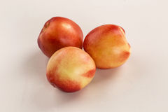 Some peaches in a white background. Fresh fruits Stock Image
