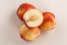Some peaches in a white background. Fresh fruits Royalty Free Stock Images