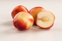 Some peaches in a white background. Fresh fruits Royalty Free Stock Image