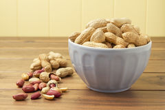 Some peanuts in a cyan bowl Stock Photography