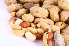 Some peanuts over red backgrou Royalty Free Stock Photos