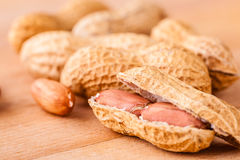 Some peanuts on wood Royalty Free Stock Images