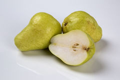 Some pears in a basket over a white background. Stock Photo