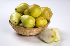 Some pears in a basket over a white background. Fresh fruits royalty free stock photos