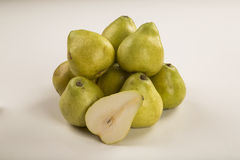 Some pears in a basket over a white background. Fresh fruits Royalty Free Stock Photo