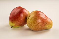 Some pears in a basket over a white background. Stock Photos