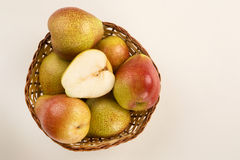 Some pears in a basket over a white background. Fresh fruits Royalty Free Stock Photography